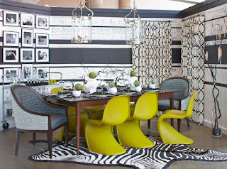 Eclectic Dining Room with Green Upholstered Dining Chairs and Wooden Table under the Unusual Glass Lamps