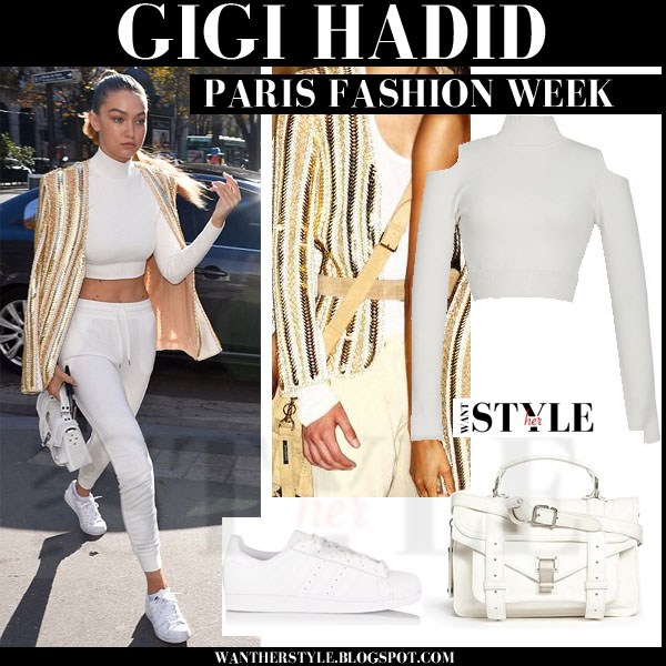 Gigi Hadid in gold Balmain jacket, white crop top, white sweatpants and white sneakers models off duty paris fashion week 2015