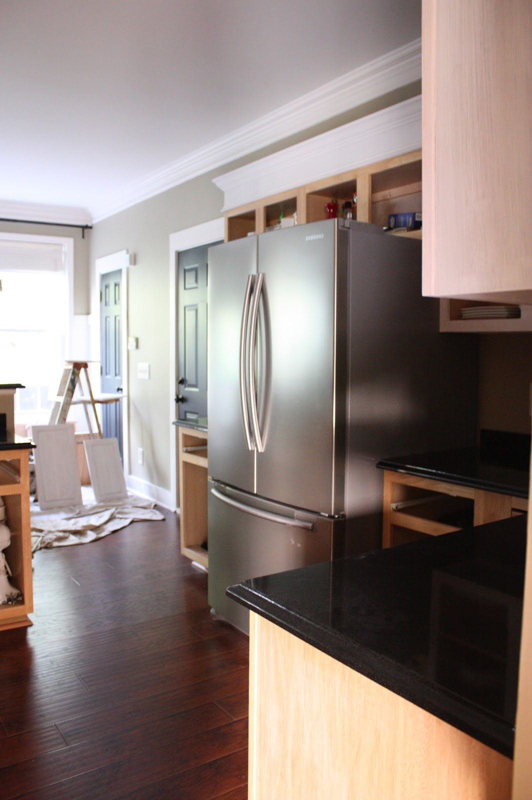 the yellow cape cod: painting kitchen cabinets (painted cabinetry)