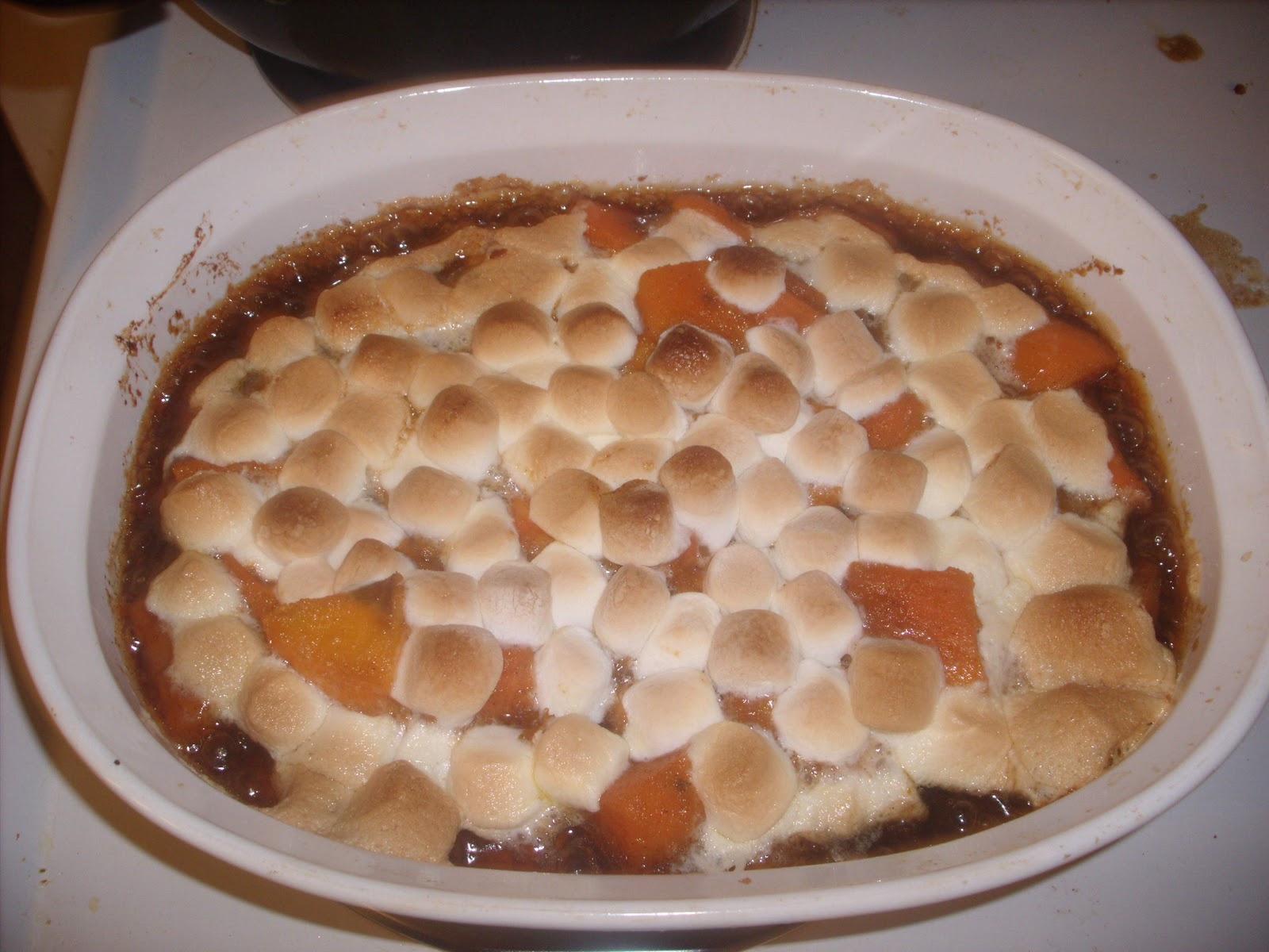 candied sweet potatoes with marshmallows on top