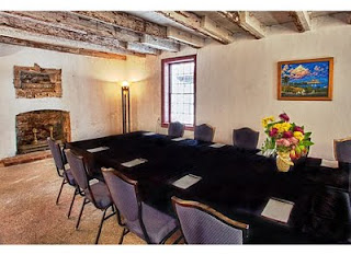 A Premier Small Retreat Destination 2 Table+and+fireplace+view St. Francis Inn St. Augustine Bed and Breakfast
