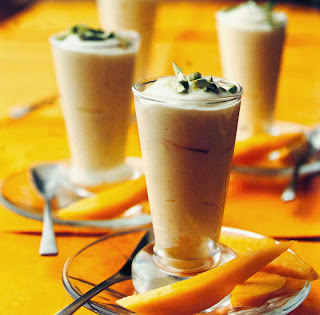Creamy Saffron Yoghurt Recipe: An indulgent vegetarian dessert for Diwali, served in glasses topped with pistachio nuts and accompanied by mango