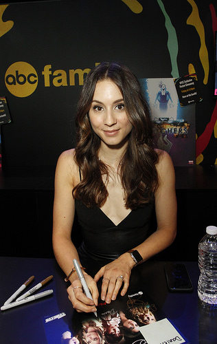 Troian Bellisario (Spencer) signing autographs at New York Comic Con