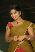 Midhuna latest sizzling pics in half saree-thumbnail-18
