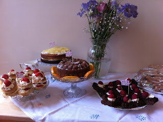 delicious homemade cakes on vintage cake stands made by the bridesmaid for the hen party