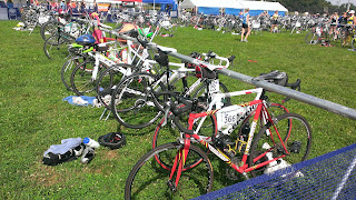 bicycles on racks in a duathlon transition area