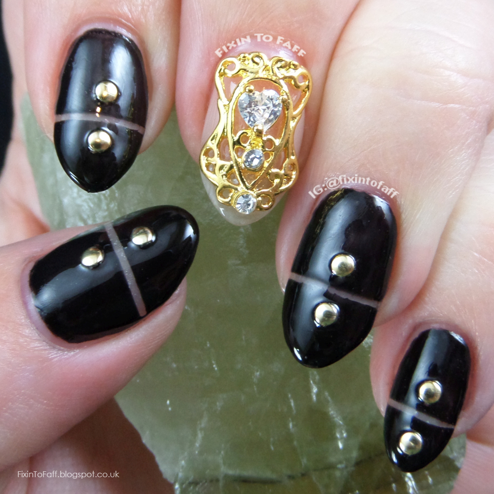 Black and gold 3D negative space nail art inspired by fashion for the Nail Challenge Collaborative.