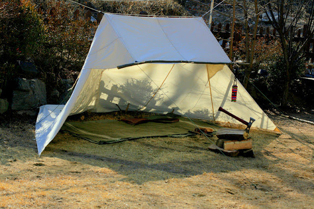 He made a reduced sized Whelen from some lighter weight canvas and it clocked it at am impressive 3.13lbs. & Baker tent or Bill Mason Tent - Canoetripping.net Forums.