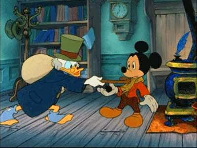 scrooge walks inside and we see mickey mouse as bob cratchit we see that cratchit is overworked but is underpaid but he still puts up with scrooges - Mickey Mouse A Christmas Carol
