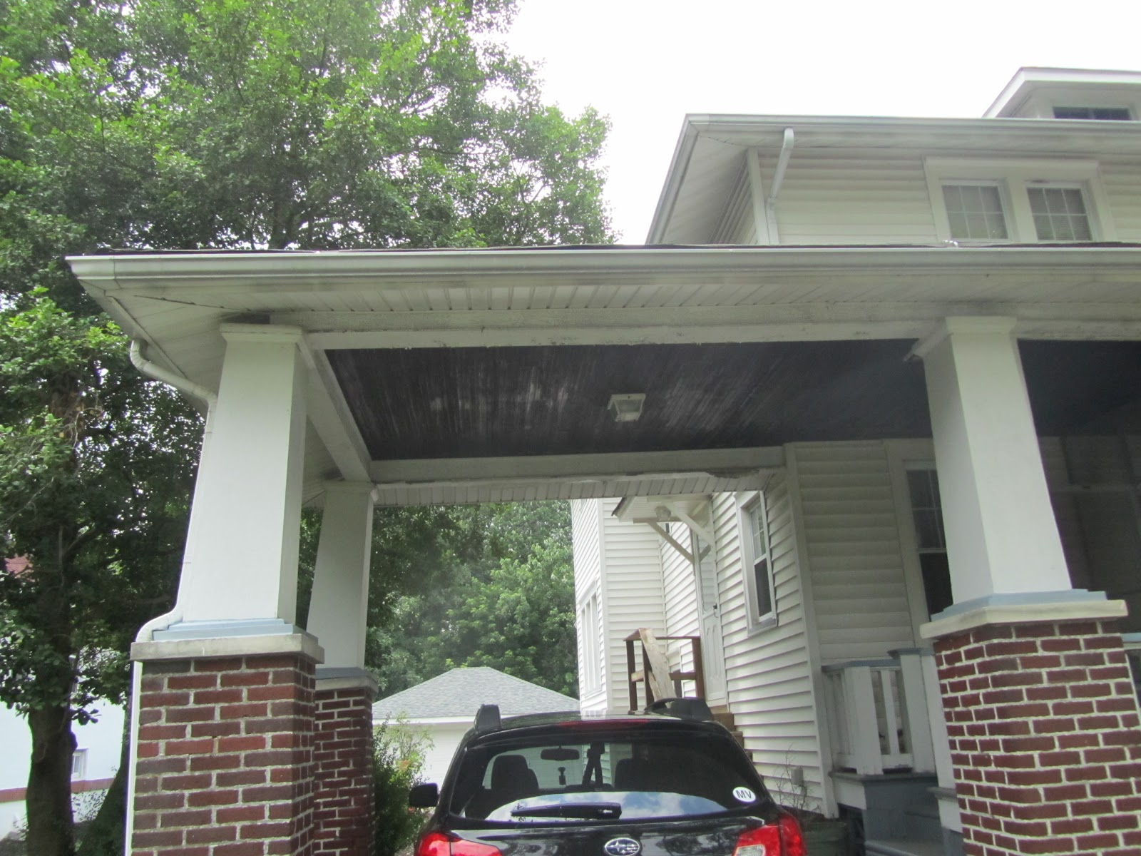 Our 39 new 39 to us 1910 foursquare home carport brick piers for Brick carport