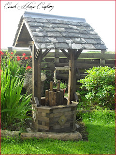 wooden well, wishing well, scrap wood well