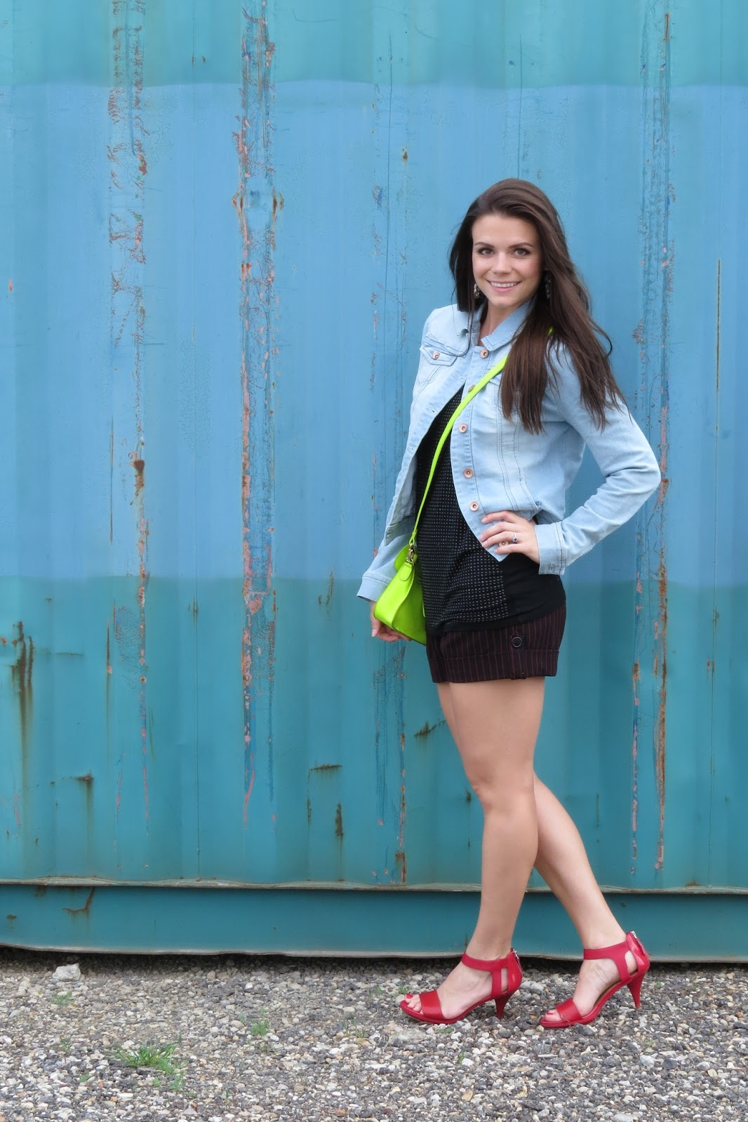 denim jacket, jean shorts, neon crossbody bag and red sandals