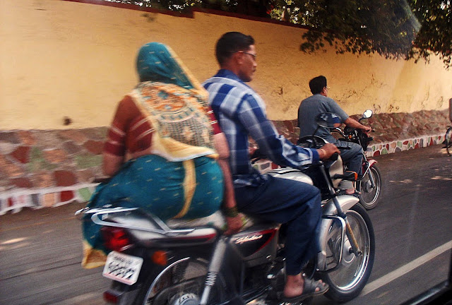 fat woman on two-wheeler
