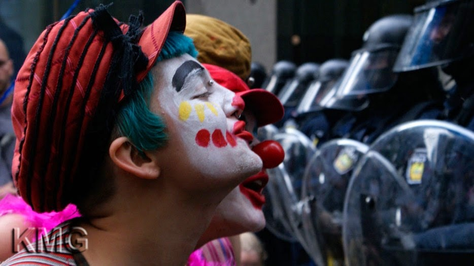 35 moments of violence that brought out incredible human compassion - protesters dressed as clowns entertain guards at a g20 meeting