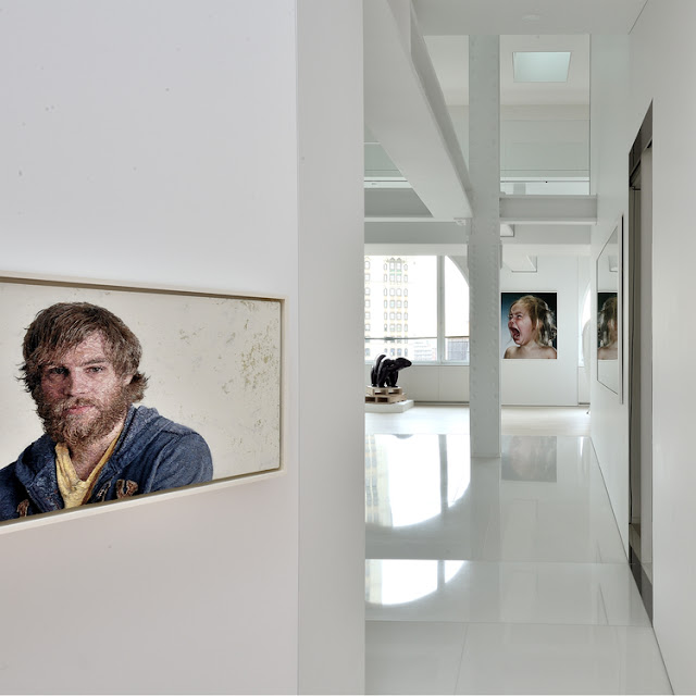 Portraits on the white penthouse walls