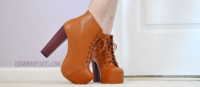 Milanoo's Jeffrey Campbell Lita dupes are offered in tan and black, with a tall wooden heel and faux-leather lace-up shell.