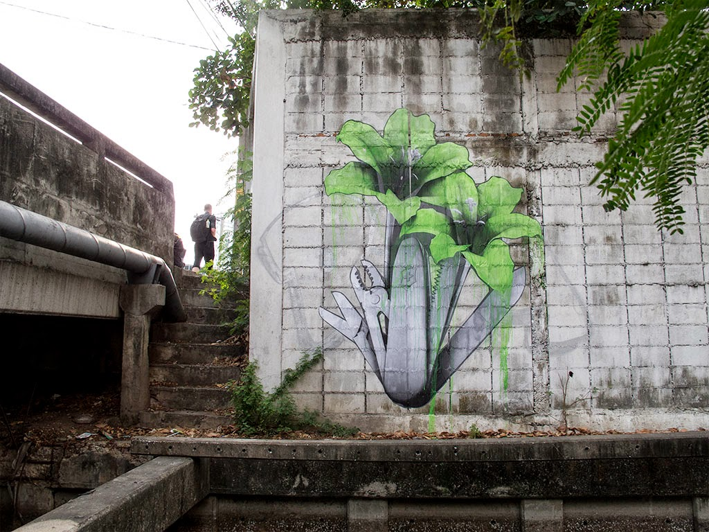 Parisian street artist Ludo has been spending a few days on the streets of Bangkok, Thailand where he's been working on several new piece.