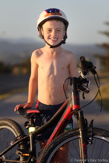 "Taylor Lilley, 9, Napier, has a zipper on his chest and is missing a belly button, after being born with a congenital heart defect. He'll be cycling 5km in the Lake Taupo Cycle Challenge this weekend, raising money for other ""zipper kids."" photograph"