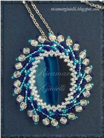 swirling sun, st Petersburg chain circolare con perline, mezzi cristalli e agata blu