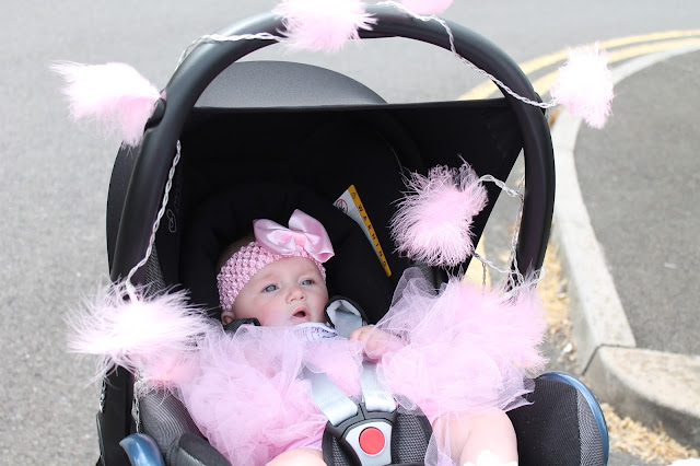 pushchair and baby dressed up for race for life