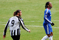 Drogba and Carroll in Chelsea against Newcastle United