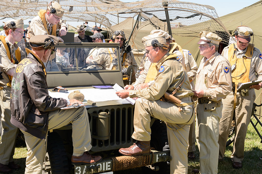 Reenactors reviewing flight plans at WWII Weekend