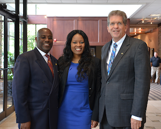 Pictured (left to right): Larry Price,  Representative Alicia Reece, Philip E. Cole