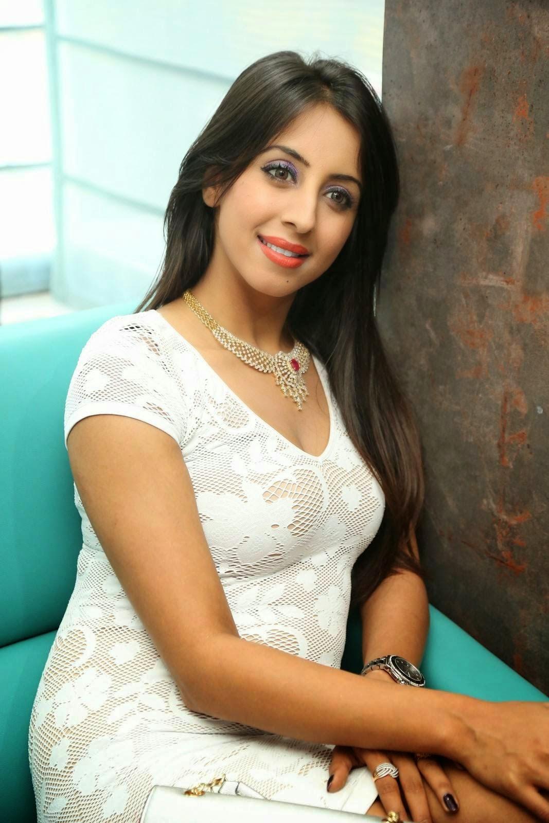 Sanjjanaa (Archana Galrani) Hot Photos in Short Dress at Sapphire Spa Launch