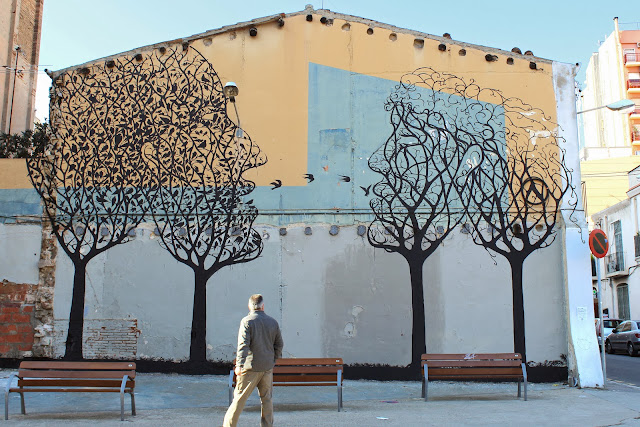 Street Art By Spanish Artist Sam3 On The Streets Of Barcelona in Spain. 1