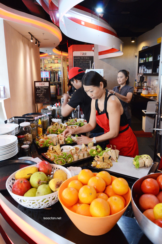 The good folks from The Daily Habit Cafe, Bangsar Shopping Centre preparing our delicious wraps