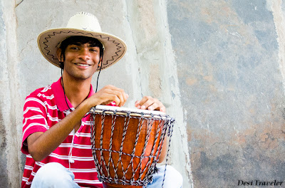 music mango tree restaurant hampi man in hat with drum
