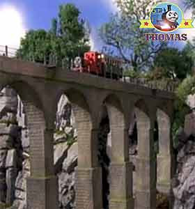 Train Thomas and friends Rheneas the tank engine on Island of Sodor railway viaduct bridge crossing