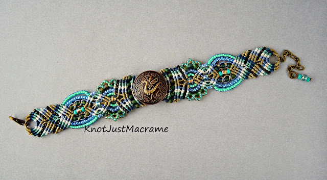 Dragon bracelet in teal, turquoise, blue and khaki by Sherri Stokey