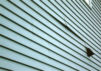 Abc seamless home specialists vinyl siding the bad for Hail damage vinyl siding