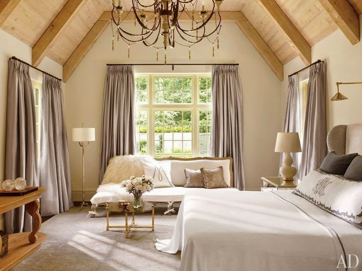beautiful traditional neutral bedroom with floor lamps