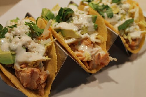 Salmon tacos with cabbage slaw, avocado and chipotle lime crema