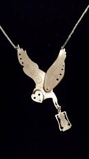 https://www.etsy.com/listing/218475459/sterling-silver-barn-owl-pendant