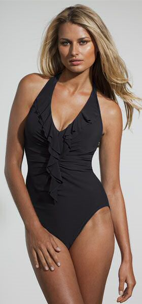 Curvy woman wearing black miraclesuit swimwear looking 10 pounds lighter