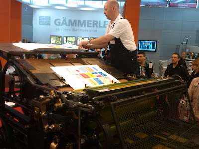 staff working the press at drupa print media fair 2012