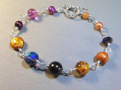 https://www.etsy.com/listing/256632210/waikiki-sunset-orange-and-purple-pearls