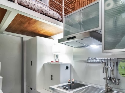 08-Kitchen-With-Bed-Living-Above-Smallest-House-in-Italy-75-sq-Feet-7-m2-Italian-Architect-Marco-Pierazzi-www-designstack-co