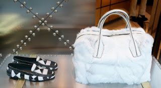 Tods black and white loafers and white fur tote.