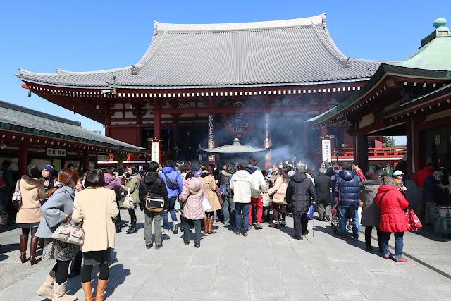 Heading to the main temple's hall of Asakusa Sensoji Temple in Tokyo, Japan