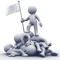 cartoon image of a winner staking hi flag over a pile of loosers
