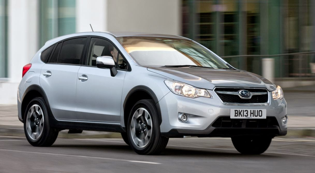 picture of a subaru xv on a road travelling from left to right