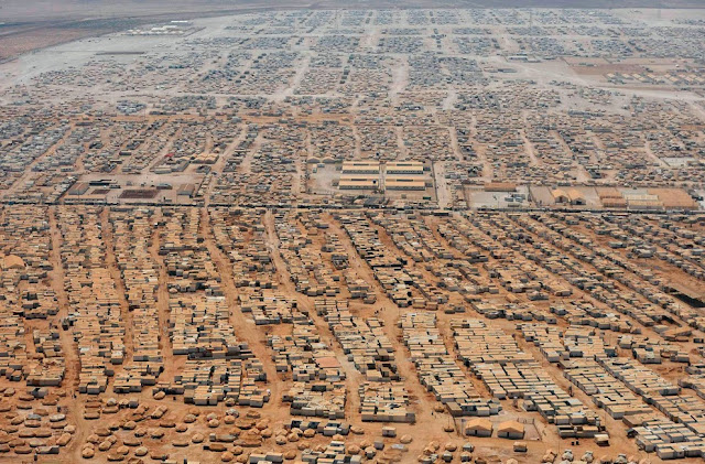 An aerial view of the Zaatari refugee camp, near the Jordanian city of Mafraq on July 18. The civil war that has unfolded in Syria over the past two and a half years has killed more than 100,000 people and driven millions from their homes. (Mandel Ngan/Reuters)
