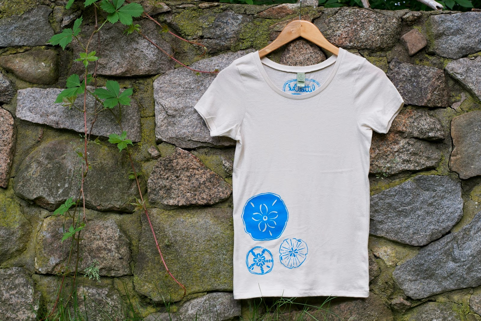 New print, new tee! Organic cotton printed with original sand dollar design.
