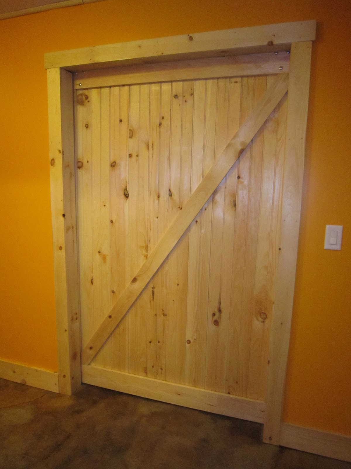 Between trees off the grid easy barn doors for Exterior 1x4 trim