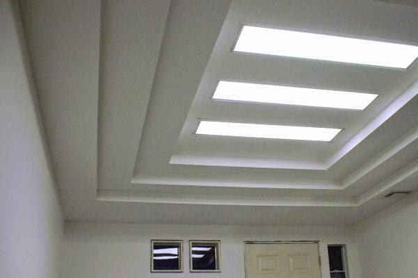 Multilevel suspended ceiling of plasterboard preparing for