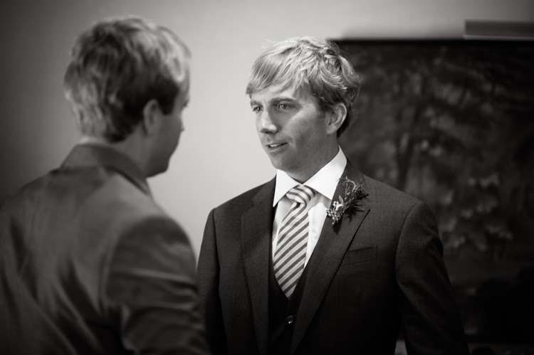 groom and best man shaking hands before the wedding ceremony